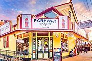 Parkway Bakery & Tavern is pictured at sunset, November 12, 2015, in New Orleans, Louisiana. Parkway was founded in 1911 and is known for its po' boys, which it it began serving in 1929 to help feed striking streetcar conductors. Parkway sells 25 varieties of po' boys, made from a variety of ingredients including alligator, seafood, and sausage. The restaurant was heavily damaged during Hurricane Katrina, taking on six feet of water, but it reopened in December 2005 to feed the residents who braved the post-hurricane conditions to return to their beloved city. (Photo by Carmen K. Sisson/Cloudybright)