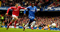 Photo: Ed Godden/Sportsbeat Images.<br /> Chelsea v Nottingham Forest. The FA Cup. 28/01/2007.<br /> Chelsea's Michael Essien (R), is held back by Nathan Tyson.