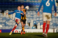Ronan Curtis of Portsmouth clears the ball under pressure from Lewis Coyle of Hull City during the EFL Sky Bet League 1 match between Portsmouth and Hull City at Fratton Park, Portsmouth, England on 23 January 2021.