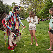 Danny Gear, Monacan, explains his regalia to Georgetown students, Caitlin Hickey, center, and Claire Mittermiller, during the first annual Georgetown University Powwow, organized by the newly formed Native American Student Council.  Powwows, even if they're organized by different tribes are usually open to all tribes and offer an opportunity to interact with and educate the public.