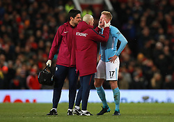 Manchester City's Kevin De Bruyne (right) receives treatment after picking up an injury