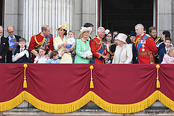 Prince William, Duke of Cambridge, Catherine, Duchess of Cambridge, Prince Louis of Cambridge, Prince George of Cambridge, Princess Charlotte of Cambridge, Camilla, Duchess of Cornwall, Prince Charles, Prince of Wales, Princess Anne, The Princess Royal, Queen Elizabeth ll, Prince Andrew, Duke of York, Prince Harry, Duke of Sussex and Meghan, Duchess of Sussex stand on the balcony of Buckingham Palace following Trooping the Colour in London