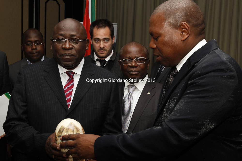 Guy Matondo Kingolo (left), the provincial Minister of Finance, Economy, Trade, Industry, Small and Medium Enterprises of the Democratic Republic of the Congo's Kinshasa Province receives a painted ostrich egg from Zweli Mkhize, the premier of South Africa's KwaZulu-Natal province as Andre Kimbuta (centre, glasses), the governor of the Kinshasa province looks on. Picture: Giordano Stolley
