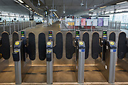 As the Coronavirus pandemic spreads across the UK, businesses and entertainment venues not already closed with the threat of job losses, struggle to stay open with growing rumours of a lockdown and travel restrictions around the capital. Londoners start to work from home leading to deserted platform barriers at Blackfriars railway station, on 19th March 2020, in London, England.