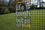Local response to Coronavirus is felt on a street by street level with some yarn bombing slogans on fences in Kings Heath Park on 13th April 2020 in Birmingham, England, United Kingdom. Coronavirus or Covid-19 is a new respiratory illness that has not previously been seen in humans. While much or Europe has been placed into lockdown, the UK government has put in place more stringent rules as part of their long term strategy, and in particular social distancing.