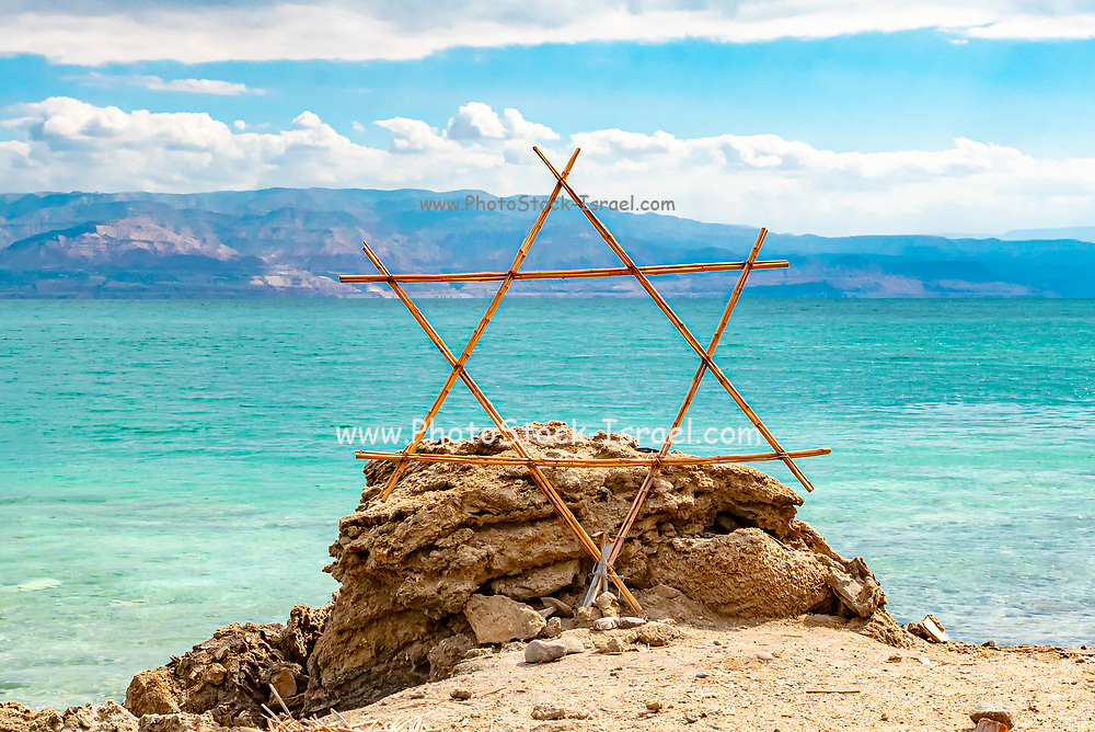 Wooden Shield of David (Magen David or Star of David) with the Dead Sea in the background