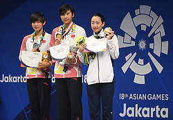 JAKARTA, Aug. 24, 2018  Gold medalist Wang Jianjiahe (C) of China and silver medalist Li Bingjie (L) of China attend the awarding ceremony of women's 400m freestyle final of swimming at the 18th Asian Games in Jakarta, Indonesia, Aug. 24, 2018. (Credit Image: © Pan Yulong/Xinhua via ZUMA Wire)