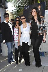 Kris Jenner, Kourtney, Kim and Khloe Kardashian attend the unveiling of Khloe Kardashian's cheeky new PeTA billboard 'Fur? I'd Rather Go Naked' on Melrose Avenue in Los Angeles, CA, USA on December 10, 2008. Photo by Apega/ABACAPRESS.COM    172634_002