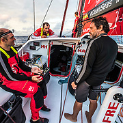 Leg 4, Melbourne to Hong Kong, day 18 on board MAPFRE, Xabi Fernandez, Pablo Arrarte and Joan Vila talking, Sophie Ciszek at the mast. Photo by Ugo Fonolla/Volvo Ocean Race. 18 January, 2018.