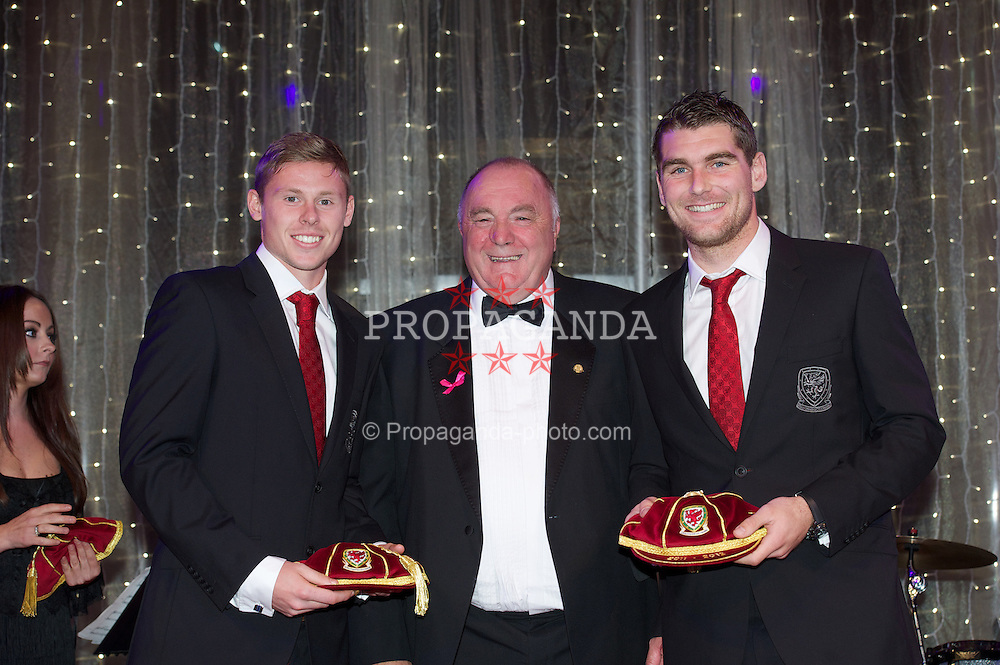 CARDIFF, WALES - Monday, October 8, 2012: Wales' FAW President Trevor Lloyd-Hughes presents caps to Simon Church [l] and Sam Vokes [r] during the FAW Player of the Year Awards Dinner at the National Museum Cardiff. (Pic by David Rawcliffe/Propaganda)