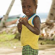 Papua kid having blond curly hair