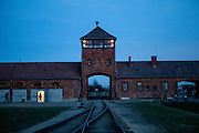 The gate house and railroad at the Auschwitz Birkenau Nazi concentration camp. It is estimated that between 1.1 and 1.5 million Jews, Poles, Roma and others were killed in Auschwitz during the Holocaust in between 1940-1945.