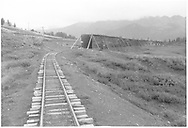 A view at Lizard Head looking east showing the west end of the RGS snowshed and section house taken from the rear of Barriger's inspection train.<br /> RGS  Lizard Head, CO  Taken by Barriger, John W. III - 9/9/1935<br /> Thanks to Don Bergman for additional information.