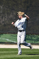 14 April 2013:  Tyler Wargo nabs a fly ball for an out during an NCAA division 3 College Conference of Illinois and Wisconsin (CCIW) Baseball game between the Elmhurst Bluejays and the Illinois Wesleyan Titans in Jack Horenberger Stadium, Bloomington IL