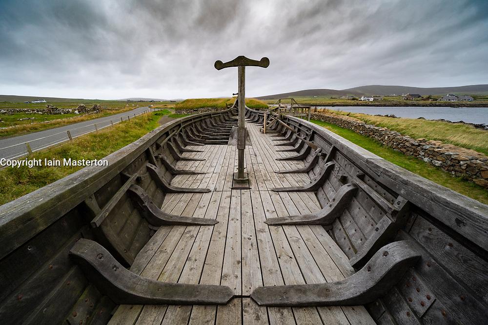 Viking longhouses and reconstructed Viking longboat at Haroldswick, Unst, Shetland, Scotland, UK