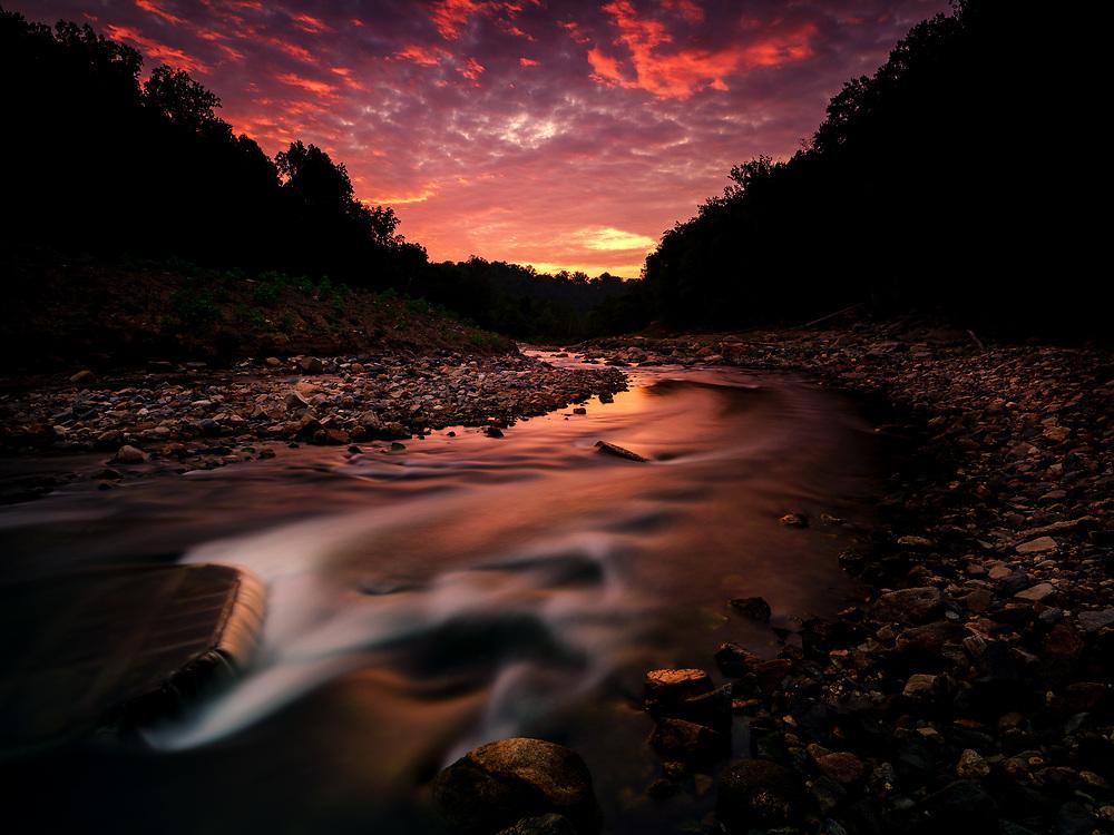 Dramatic sunrise over the Patapsco River in Ellicott City, Maryland.