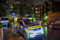 © Licensed to London News Pictures. 18/02/2020. London, UK. A police vehicle sits on St Mark's Grove outside a block of flats where police were called at around 18:50GMT on Monday, 17 February. London Ambulance Service reported they had been called to an unresponsive man inside a property. A 54-year-old-man was found with head injuries at the premises. He was pronounced dead at the scene. Photo credit: Peter Manning/LNP