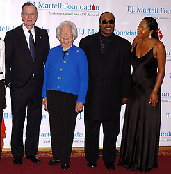 Former President George Bush and his wife Barbara along with Stevie Wonder and his daughter Aisha pose for pictures prior to be honored at the 29th annual T.J. Martell Foundation Awards Gala held at the New York Hilton on Thursday May 27, 2004. (Pictured : George Bush, Barbara Bush, Stevie Wonder, Aisha Wonder). Photo by nicolas Khayat/ABACA.  | 60624_02