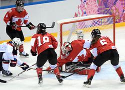 20-02-2014 IJSHOCKEY: OLYMPIC GAMES: SOTSJI<br /> De finale tussen USA en Canada wordt door Canada in de extra tijd door een golden goal met 3-2 gewonnen / Anne Schleper (15) probeert goalie Shannon Szabados te verrassen<br /> ©2014-FotoHoogendoorn.nl