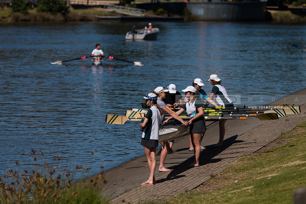 Students lift their boat after rowing training during the 35th day of zero COVID-19 cases in Victoria, Australia. School and community sport is ramping up and as the weather improves, more people are venturing out and about to enjoy this great city. Pressure is mounting on Premier Daniel Andrews to keep his promise of removing all remaining restrictions. (Photo by Dave Hewison/Speed Media)