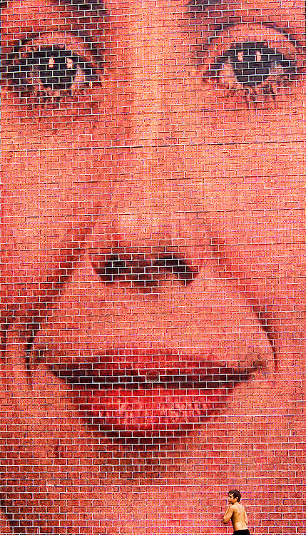Closeup view of image in glass tower at Crown Fountain in Millenium Park, Chicago, Illinois. The 50-foot glass block tower is one of two designed by Jaume Plensa, which projects video images of faces of Chicago citizens onto an LED screen.