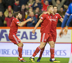 Aberdeen's Sam Cosgrove (centre) celebrates scoring his side's first goal of the game during the Ladbrokes Scottish Premiership match at Pittodrie Stadium, Aberdeen.