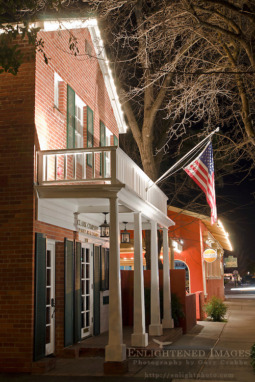 Colonial-style Brick building at night with American Flag flying in front, downtown Paso Robles, San Luis Obispo County, California
