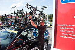 A WM3 Pro Cycling Team mechanic puts on a spare bike on the team car before the Crescent Vargarda - a 42.5 km team time trial, starting and finishing in Vargarda on August 11, 2017, in Vastra Gotaland, Sweden. (Photo by Balint Hamvas/Velofocus.com)