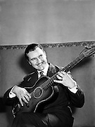 """Special for Radio Review - Charlie McGee, Singer with Guitar.12/02/1955..Balladeer Charlie McGee dies aged 89. .Monday, 30 September 2002.Those of you familiar with the song """"The Homes of Donegal"""" may or may not know that it was made famous back in the 1960s by Derry born singer Charlie McGee - it was written by his brother-in-law Seán McBride. For a little over a decade Charlie McGee was tremendously popular in Ireland, singing Irish ballads to his own guitar accompaniment. When his star began to wane he moved to the US for 15 years, before retiring to Co. Wicklow in 1979. Charlie McGee died on Monday at the age of 89."""