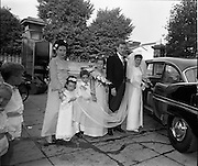"""16/09/1967<br /> 09/16/1967<br /> 16 September 1967<br /> Wedding of Mr Francis W. Moloney, 28 The Stiles Road, Clontarf and Ms Antoinette O'Carroll, """"Melrose"""", Leinster Road, Rathmines at Our Lady of Refuge Church, Rathmines, with reception in Colamore Hotel, Coliemore Road, Dalkey. Image shows the Bride and Groom getting into the car after the ceremony. Matron of Honour Gladys McGloughlin on left."""