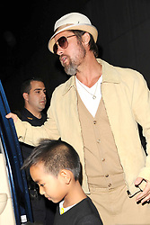 September 25, 2009, New York City Actor Brad Pitt AND Maddox Jolie-Pitt at Dave and Buster's September 25, 2009 in New York City (Credit Image: Sharkpixs/ZUMAPRESS.com)
