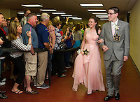 Emily Paronto and Michael O'Brien stop for a photo op during LHS Junior Prom March at the Opechee Conference Center Friday evening.  (Karen Bobotas/for the Laconia Daily Sun)