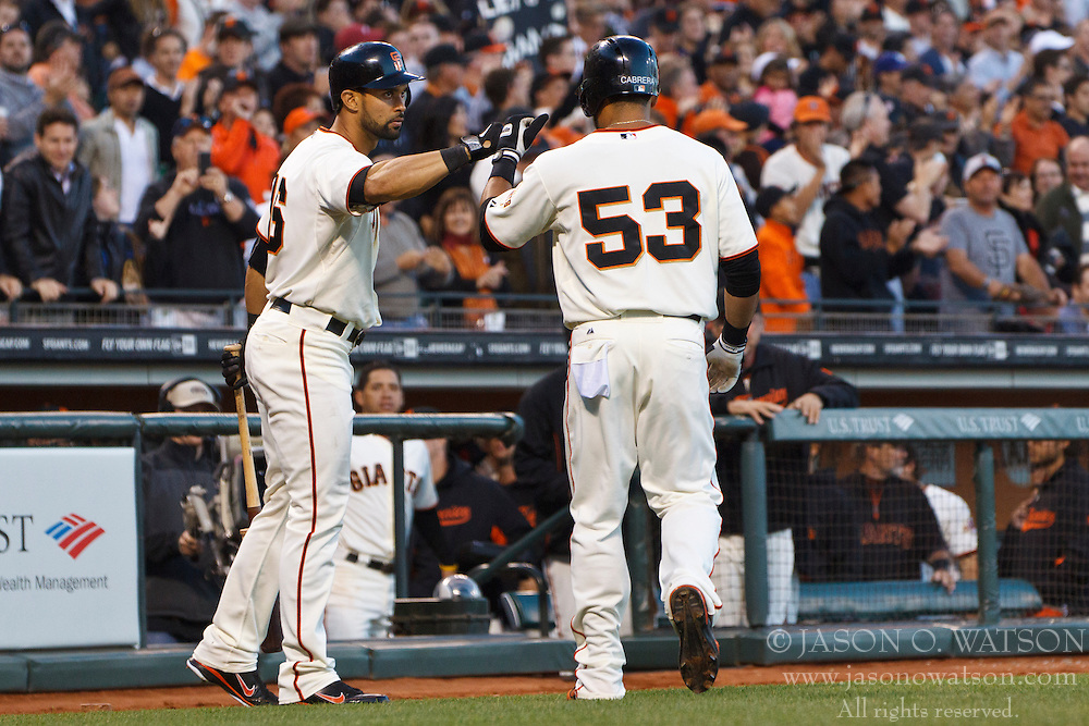 SAN FRANCISCO, CA - JUNE 26: Melky Cabrera #53 of the San Francisco Giants is congratulated by Angel Pagan #16 (left) after hitting a home run against the Los Angeles Dodgers during the fourth inning at AT&T Park on June 26, 2012 in San Francisco, California. The San Francisco Giants defeated the Los Angeles Dodgers 2-0. (Photo by Jason O. Watson/Getty Images) *** Local Caption *** Melky Cabrera; Angel Pagan