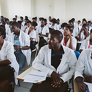 INDIVIDUAL(S) PHOTOGRAPHED: Peterson Larrieux (center). LOCATION: University of the Artistide Foundation (UNIFA), Tabarre Commune, Port-au-Prince, Haïti. CAPTION: Peterson Larrieux, a medical student from the University of the Artistide Foundation (UNIFA), sits in a classroom during a training.