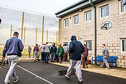 Prisoners leaving to go to work. Beaufort House, a skill development unit for enhanced prisoners. Part of HMP/YOI Portland, a resettlement prison with a capacity for 530 prisoners.Dorset, United Kingdom.