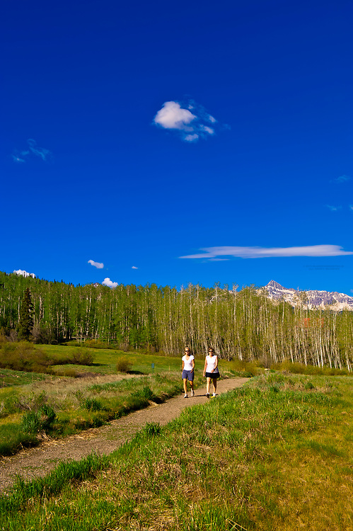 Women walking, Telluride Mountain Village, Telluride, Colorado USA