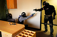 """DENVER, CO - MARCH 24: A student (C) protects an unarmed person (L) in a defensive scenario during a Tac*One Consulting """"Lone Wolf"""" civilian active shooter response course for concealed weapons permit holders on March 24, 2018 in Longmont, Colorado. The class, based on a similar law enforcement course, is designed to challenge students mentally and physically leaving with a solid plan to defend themselves and others during the critical first moments of a deadly attack. (Photo by Rick T. Wilking/Getty Images)"""