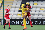 Aberdeen's Andrew Considine (4) and Jay Emmanuel-Thomas (9) of Livingston battles for possession, tussles, tackles, challenges, during the Scottish Premiership match between Livingston and Aberdeen at Tony Macaroni Arena, Livingstone, Scotland on 1 May 2021.