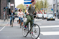 © Licensed to London News Pictures. 07/04/2014. Rotterdam, The Netherlands. Dutch cyclists cycling on the 'fietspad' (bike paths physically separated from the main roadway).  On Thursday April 3rd a london cyclist was killed by a waste lorry turning at a junction in Central London, the third cyclist to die in the capital so far this year.    Dutch cyclists benefit from safer road conditions than their London counterparts as a result factors such as these cycle lanes. Photo credit : Richard Isaac/LNP