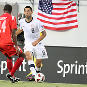 USA midfielder Clint Dempsey (8) dribbles the ball past Panama defender  Eduardo Dasent (14) during a  CONCACAF Gold Cup soccer match between the United States and Panama on Saturday, June 11, 2011, at Raymond James Stadium in Tampa, Fla. (AP Photo/Alex Menendez)