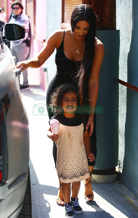 Lickety Split! Kim Kardashian leaves Museum of Ice Cream in Downtown LA with daughter, North West. 11 May 2017 Pictured: Kim Kardashian, North West. Photo credit: MEGA TheMegaAgency.com +1 888 505 6342