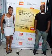 """Guests pose for a photo before a screening of BET's """"Being Mary Jane"""" at the W Hotel in Dallas, Texas on June 22, 2013."""
