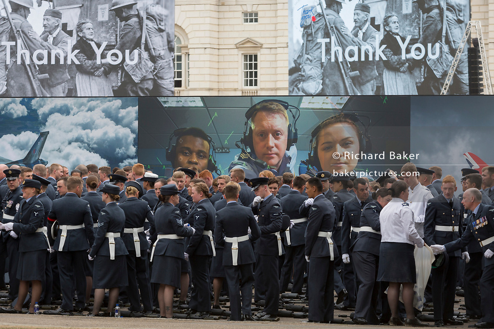 On the 100th anniversary of the Royal Air Force (RAF) and before a march andflypast of 100 aircraft formations representing Britain's air defence history which flew over central London, service personnel prepare by A RAF recruiting hoarding, on 10th July 2018, in London, England.