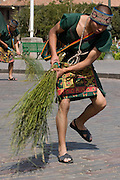 """The pichaq, or men in charge of sweeping the floor to drive away the bad spirits.  Inti Raymi """"Festival of the Sun"""", Plaza de Armas, Cusco, Peru."""