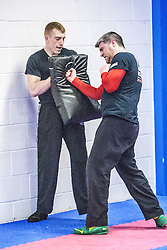 Students practising their punches on pads. Stef Noij, KMG Instructor from the Institute Krav Maga Netherlands, takes the IKMS G Level Programme seminar today at the Scottish Martial Arts Centre, Alloa.