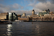 City of London behind buildings along the river. This stretch of the river is called Waterman's Walk.