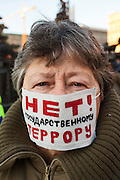 Moscow, Russia, 15/12/2012..A woman wears a masking reading ?No to state terror?  in Lubyanka Square at an unauthorised opposition rally to mark a year of protests against Vladimir Putin.