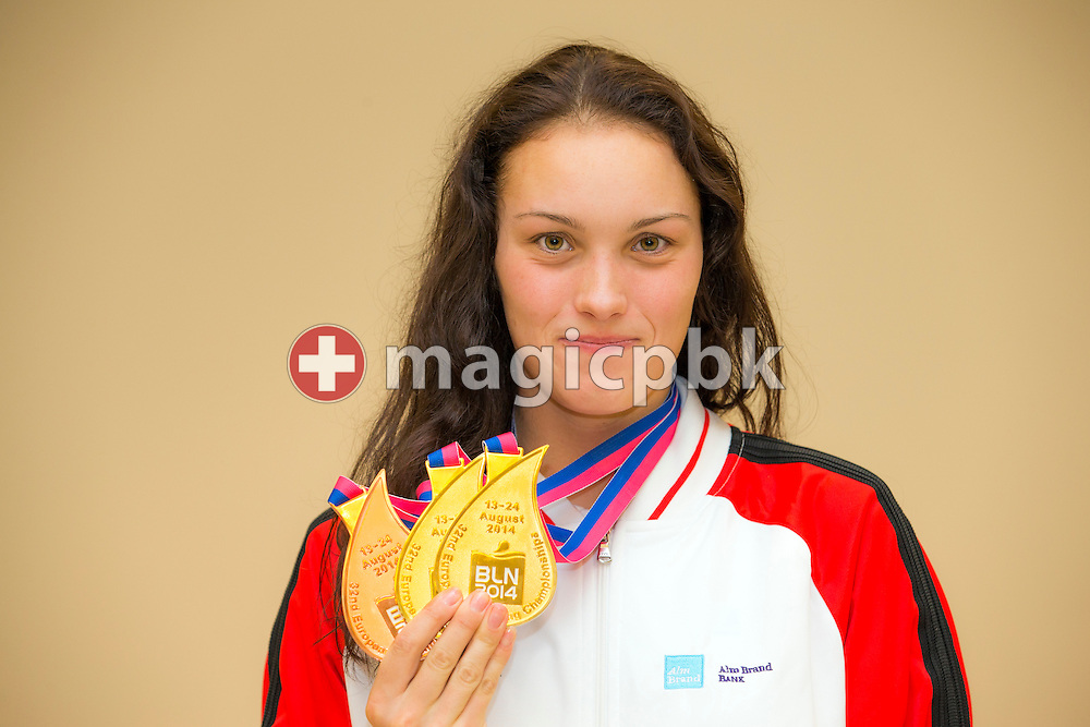 Mie Ostergaard NIELSEN of Denmark poses with her two gold medals and her bronze medal after the LEN European Swimming Championships at Europa-Sportpark in Berlin, Germany, Sunday, Aug. 24, 2014. (Photo by Patrick B. Kraemer / MAGICPBK)
