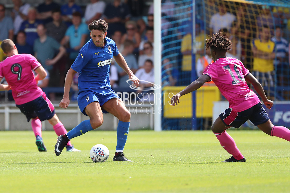 AFC Wimbledon defender Will Nightingale (5) dribbling during the Pre-Season Friendly match between AFC Wimbledon and Queens Park Rangers at the Cherry Red Records Stadium, Kingston, England on 14 July 2018. Picture by Matthew Redman.