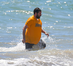 Adam Sandler takes a dip in the ocean fully clothed - 12 July 2020